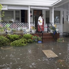 McKnight watches the level of floodwaters in the front yard of her Orange Street home in Georgetown, South Carolina