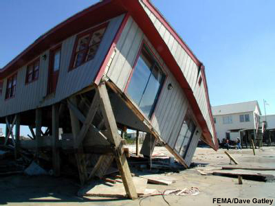fallen beach house from storm surge